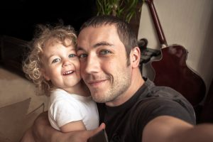 Father and daughter taking selfie